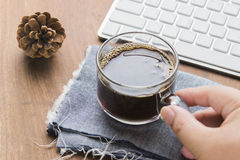 Arabica coffee cup. Cup of espresso coffee with working technology lifestyle Royalty Free Stock Photo