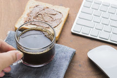 Arabica coffee cup. Cup of espresso coffee with working technology lifestyle Royalty Free Stock Image