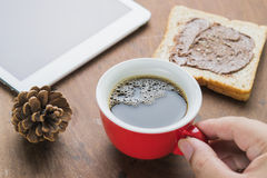 Arabica coffee cup. Cup of espresso coffee with working technology lifestyle Stock Photo