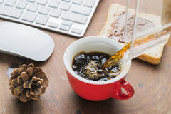 Arabica coffee cup. Cup of espresso coffee with working technology lifestyle Royalty Free Stock Images