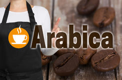 Arabica concept is shown by coffee roaster.  Royalty Free Stock Image