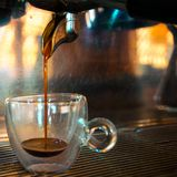 100% Arabica Geroosterde Espressobonen stock foto