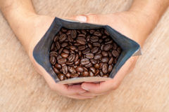 Arabica Roasted Coffee. Beans in package Stock Photography