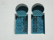 Arabien double window. This picture was taken in Tunisia on a holiday trip. It shows a typical kind of windows royalty free stock image