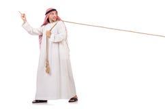 Arabier in touwtrekwedstrijdconcept Stock Fotografie