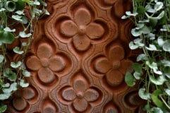 Arabische Blumenauslegung im Lehm Stockfotos