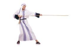 Arabische mens in touwtrekwedstrijd Stock Foto's