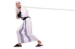 Arabische mens in touwtrekwedstrijd Stock Fotografie