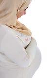 Arabische Moslim zwangere vrouw stock afbeeldingen