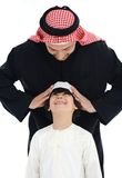 Arabische Moslimvader en zoon Stock Fotografie