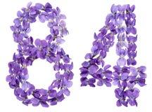 Arabische Ziffer 84, vierundachzig, von den Blumen der Viola, lokalisiert Stockfotografie