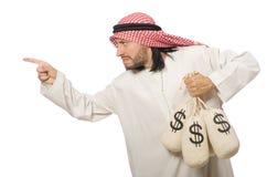 Arabischer Geschäftsmann mit Säcken Geld Stockbild