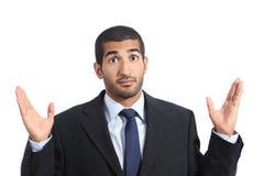 Arabischer Geschäftsmann mit einem Zweifelsgestikulieren Lizenzfreies Stockfoto