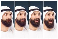 Arabischer saudischer Geschäftsmann auf dunkelblauem Studiohintergrund lizenzfreie stockbilder