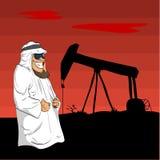 Arabischer Scheich mit einer Ölpumpe hinter ihm Stockfoto