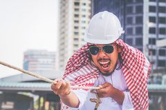 Arabisk affärsman Pull repet arkivbilder