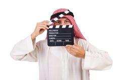 Arabisk man med filmclapperen Fotografering för Bildbyråer