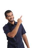 Arabisk tillskyndareman som framlägger, medan peka på sidan royaltyfria foton