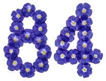 Arabiskt tal 84, åttioåfyra, från blåa blommor av lin, isola Arkivfoton