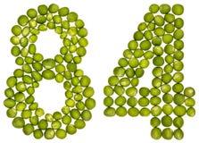 Arabiskt tal 84, åttioåfyra, från gröna ärtor som isoleras på whi Arkivbild
