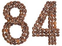 Arabiskt tal 84, åttioåfyra, från kaffebönor som isoleras på w Royaltyfri Bild