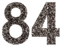 Arabiskt tal 84, åttioåfyra, från svart ett naturligt kol, I Arkivfoto
