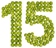 Arabiskt tal 15, femton, från gröna ärtor som isoleras på vit b royaltyfria bilder