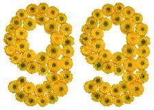 Arabiskt tal 99, nittionio, från gula blommor av smörblomman Arkivfoto