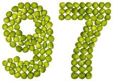 Arabiskt tal 97, nittiosju, från gröna ärtor som isoleras på wh Arkivbild