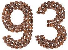 Arabiskt tal 93, nittiotre, från kaffebönor som isoleras på Arkivfoton