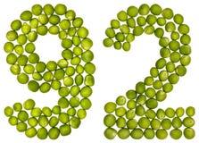 Arabiskt tal 92, nittiotvå, från gröna ärtor som isoleras på whit Arkivbilder
