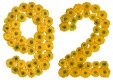 Arabiskt tal 92, nittiotvå, från gula blommor av smörblomman, Arkivfoton
