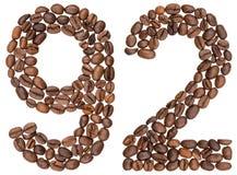 Arabiskt tal 92, nittiotvå, från kaffebönor som isoleras på wh Royaltyfria Bilder