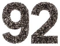Arabiskt tal 92, nittiotvå, från svart ett naturligt kol, är Arkivbild