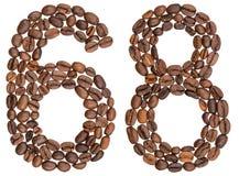 Arabiskt tal 68, sextioåtta, från kaffebönor som isoleras på w Arkivbild