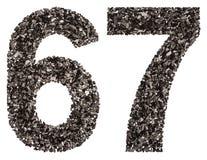 Arabiskt tal 67, sextiosju, från svart ett naturligt kol, I Arkivfoto