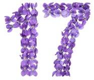 Arabiskt tal 17, sjutton, från blommor av altfiolen som isoleras på Royaltyfri Bild