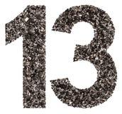 Arabiskt tal 13, tretton, från svart ett naturligt kol, isolator Royaltyfria Foton
