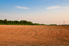 Arable. Tractor plowed field in the spring morning Stock Photo