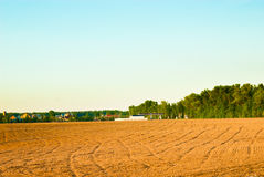 Arable. Tractor plowed field in the spring morning Stock Photography