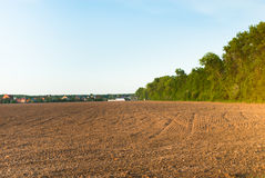 Arable. Tractor plowed field in the spring morning Stock Photos