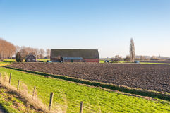 Arable farm and barn in autumn. Landscape with a plowed field and an arable farm Stock Image