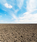 Arable field and blue sky. With clouds Stock Photos