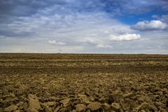 Arable field farm. Agricultural landscape of the spring arable area royalty free stock images