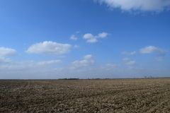 Arable field. The plowed field. Spring processing of farmlands Royalty Free Stock Image