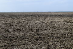 Arable field. The plowed field. Spring processing of farmlands Royalty Free Stock Photos