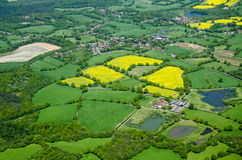 Arable fields, Aerial view. View from above of fields of yellow oil seed rape growing around the Surrey villages of Capel and Newdigate in May in rural England Stock Photo
