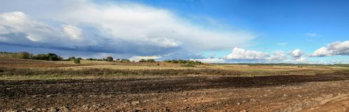 Arable fields in sunny autumn day with clouds. Arable fields on a sunny and windy autumn day with clouds stock photography