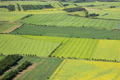 Arable land. Aerial view of farmland and some flowering rapeseed fields Stock Images