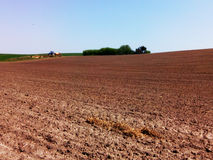 Arable land. Beautiful landscape of arable land for use as a background in advertising billboards, banners, business cards, websites related to farming and Stock Images